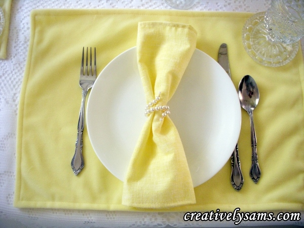 Yellow Tablescape place setting with pearl napkin ring