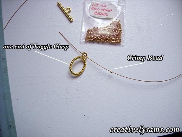 first step, threading on crimp bead & toggle clasp for Birthstone Bracelet