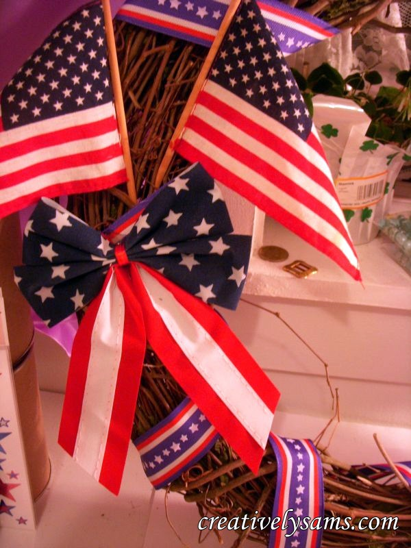 Gluing bow & flags to Patriotic Wreath
