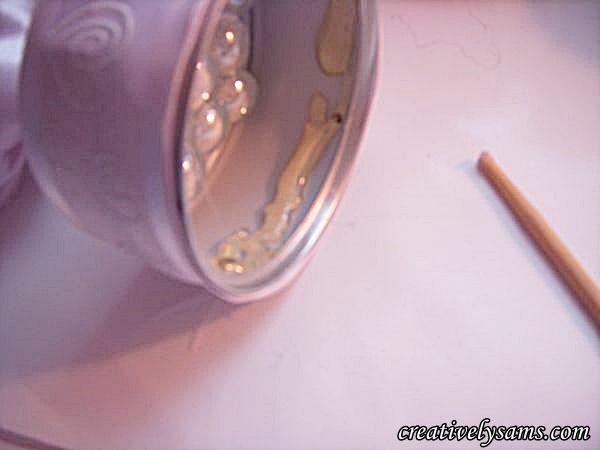 Apply hot glue to inside rim