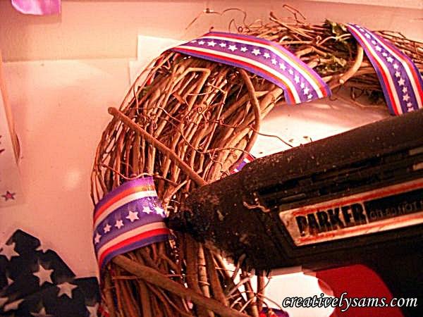 Gluing ribbon to Patriotic Wreath