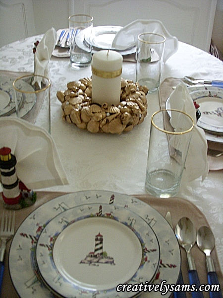 Lighthouse tablescape with gold shell centerpiece