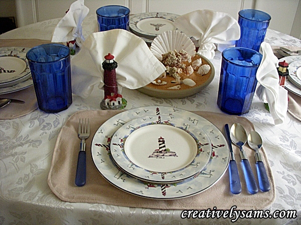 Lighthouse tablescape. sand centerpiece