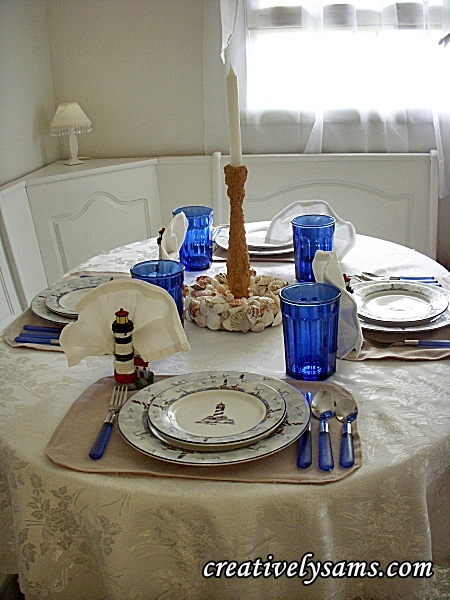 Lighthouse tablescape..shells & candlestick.