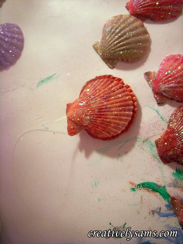 Sandwich Glittered Shell Ornaments together